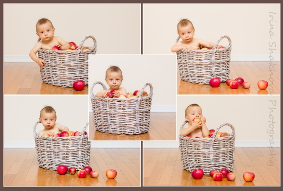 Baby in a basket of apples
